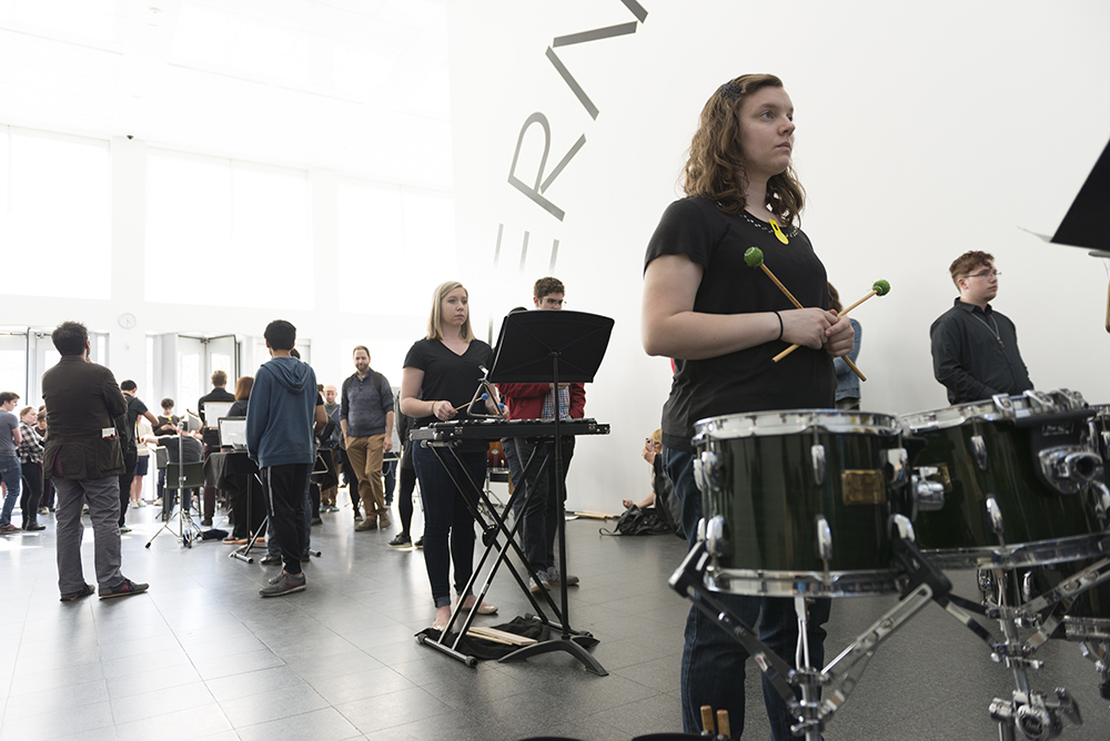 Dozens of percussionists, spread across multiple floors, gathered to perform Marta Ptaszynska's 'Voice of the Winds' at MCA Chicago
